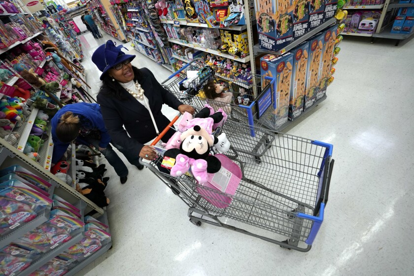 Walmart shoppers make their way through the toy aisles in Houston.