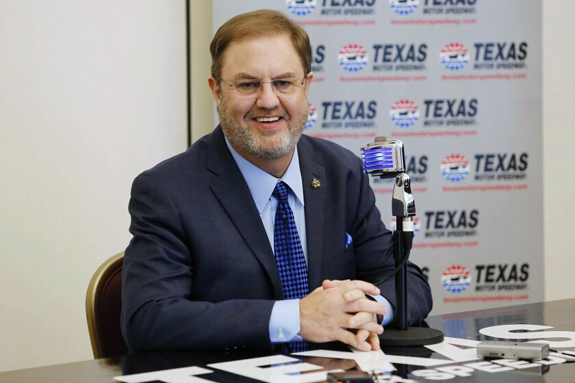 FILE - In this Feb. 27, 2019, file photo, Eddie Gossage, Texas Motor Speedway president, speaks during the track's media day in Fort Worth, Texas. Eddie Gossage is stepping down after overseeing the track's first 25 seasons of racing. Gossage said Thursday, May 13, 2021, that his final event at the track will be NASCAR's All-Star race June 13, which will be a full-circle ending to his 32 years working for Speedway Motorsports and Bruton Smith. (Ross Hailey/Star-Telegram via AP, File)