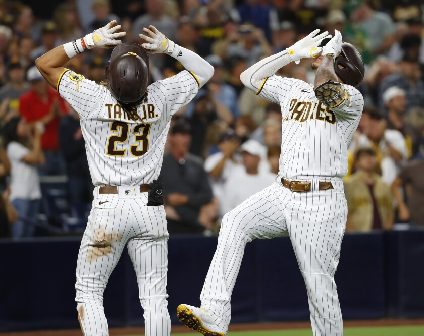 Manny Machado celebrates a home run with Fernando Tatis Jr. on July 27.