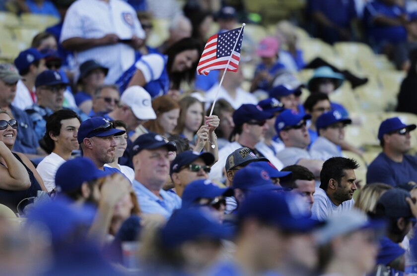 A Dodgers fan waves an American flag during the Memorial Day weekend game against the Chicago Cubs.