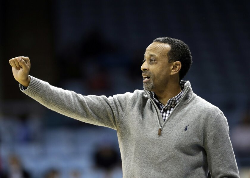 James Madison coach Kenny Brooks directs his team against North Carolina during the second half of an NCAA college basketball game in Chapel Hill, N.C., Thursday, Jan. 2, 2014. North Carolina won 74-71. (AP Photo/Gerry Broome)