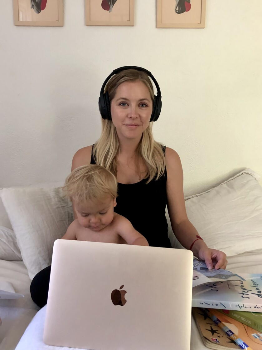Stephanie Danler juggling parenting and book promotion from her quarantine home office (bed).