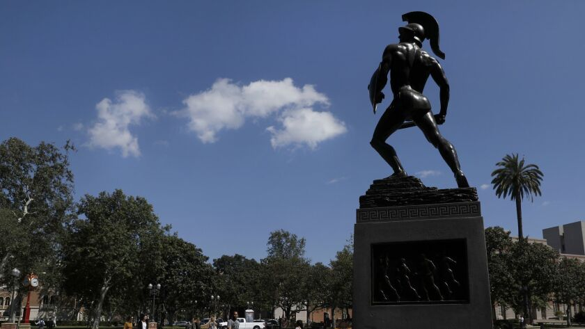 Tommy Trojan, USC's campus symbol, has seen better times.