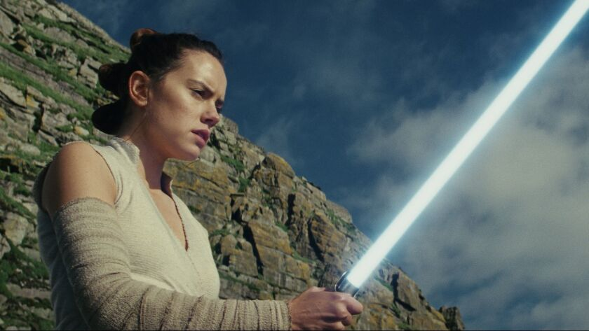 "This image released by Lucasfilm shows Daisy Ridley as Rey in ""Star Wars: The Last Jedi."" ""Star Wa"