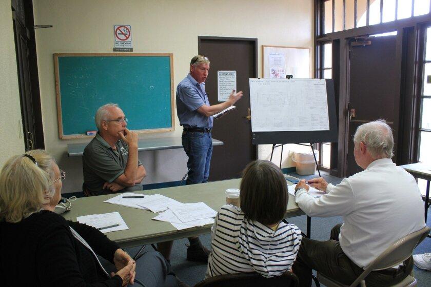Applicant Robert Bateman explains project details to DPR committee members Angeles Liera, Paul Benton, Diane Kane and Jim Ragsdale