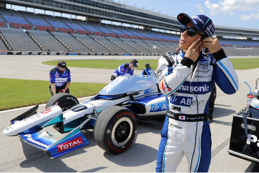 Takuma Sato stands on pit road as he prepares for qualifying for an IndyCar auto race at Texas Motor Speedway in Fort Worth, Texas, Saturday, June 6, 2020. (AP Photo/Tony Gutierrez)