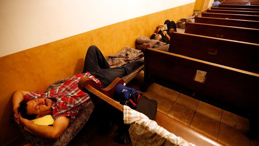 Gelacio Barraza, 42, prepares to bed down for the night at a facility that offers shelter to the hom