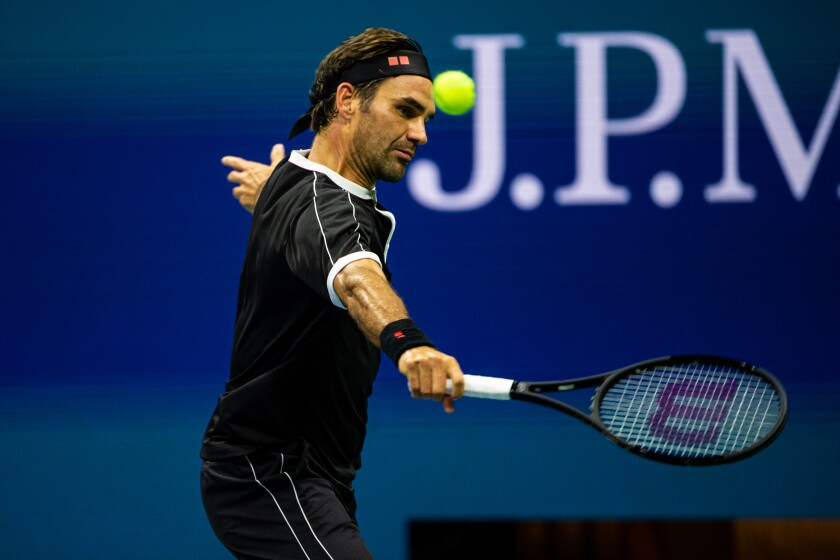 Roger Federer hits a backhand during his victory over Sumit Nagal in the first round of the U.S. Open on Monday.