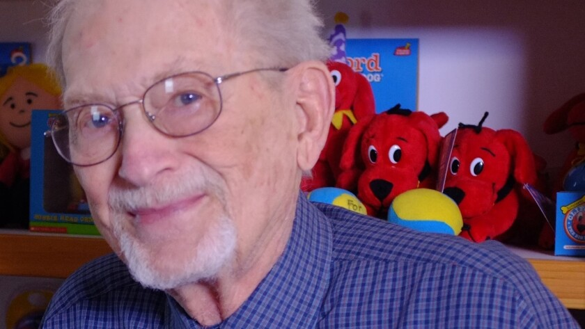 Author Norman Bridwell is shown in 2012 with his famous character, Clifford the Big Red Dog.