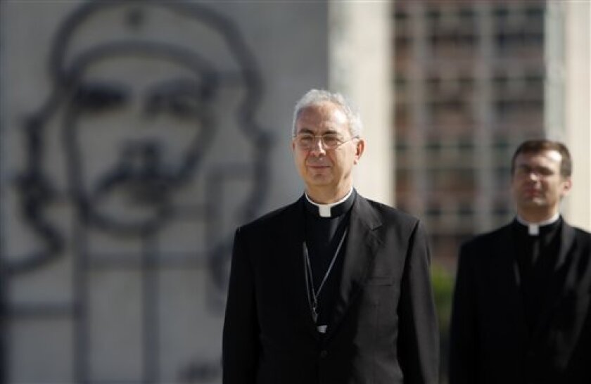 Vatican Foreign Minister Archbishop Dominique Mamberti, left, attends a wreath-laying ceremony at the Jose Marti monument in Havana, Wednesday, June 16, 2010. Mamberti is in Cuba to to discuss the island's economic plight and meet with government authorities. (AP Photo/Javier Galeano)
