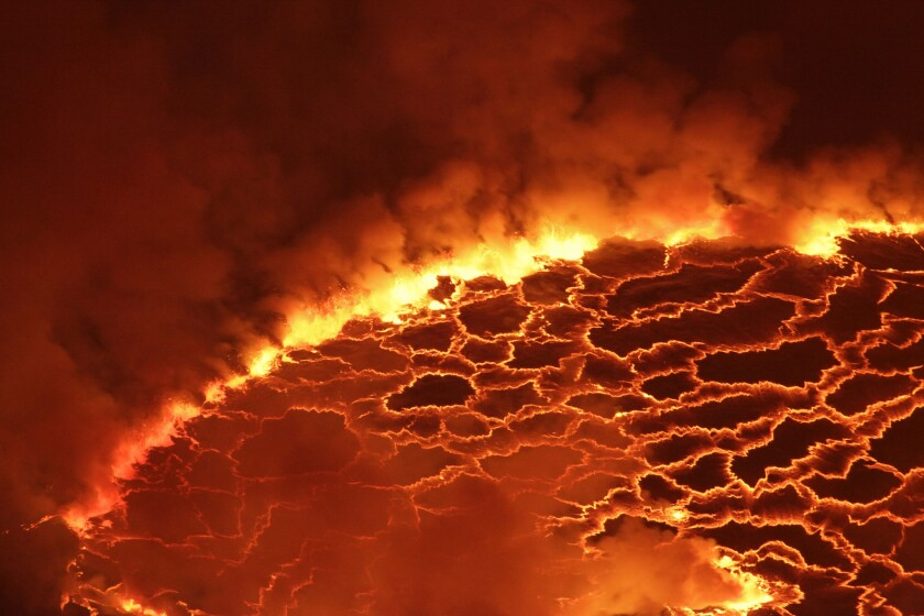 Magma churns in the lava lake of Mount Nyiragongo outside Goma, Congo. If the entire Earth did not melt during a collision 4.5 billion years ago, that means there may be a few hidden vestiges of our planet from a time before the moon.