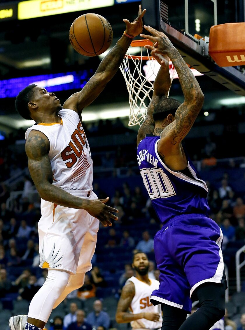 Sacramento Kings' Willie Cauley-Stein (00) has his shot blocked by Phoenix Suns' Eric Bledsoe during the first half of an NBA basketball game, Wednesday, Nov. 4, 2015, in Phoenix. (AP Photo/Matt York)