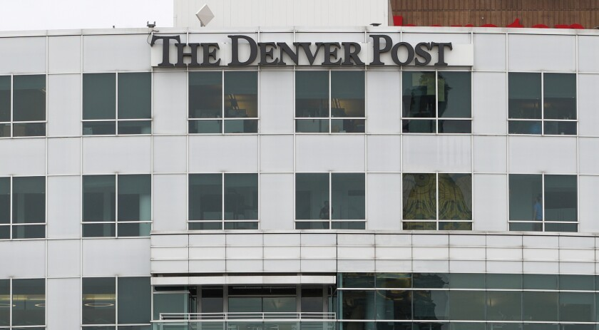 FILE - This April 16, 2018, file photo shows the sign for The Denver Post on the side of the newspap