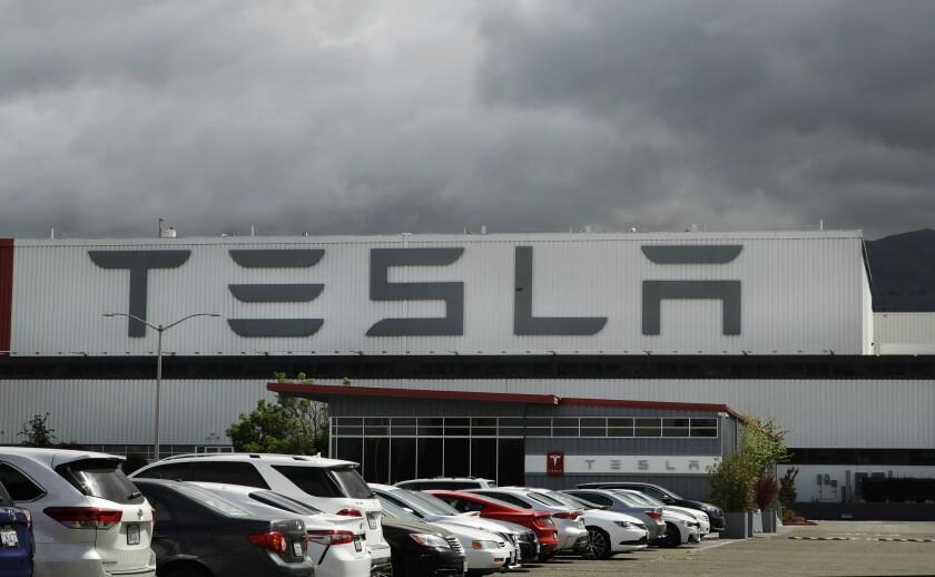 Virus Outbreak Tesla