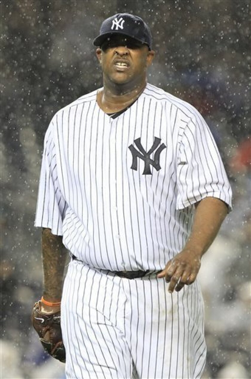 New York Yankees starting pitcher CC Sabathia leaves the field during the second inning against the Detroit Tigers during Game 1 of baseball's American League division series Friday, Sept. 30, 2011, at Yankee Stadium in New York. (AP Photo/Frank Franklin II)