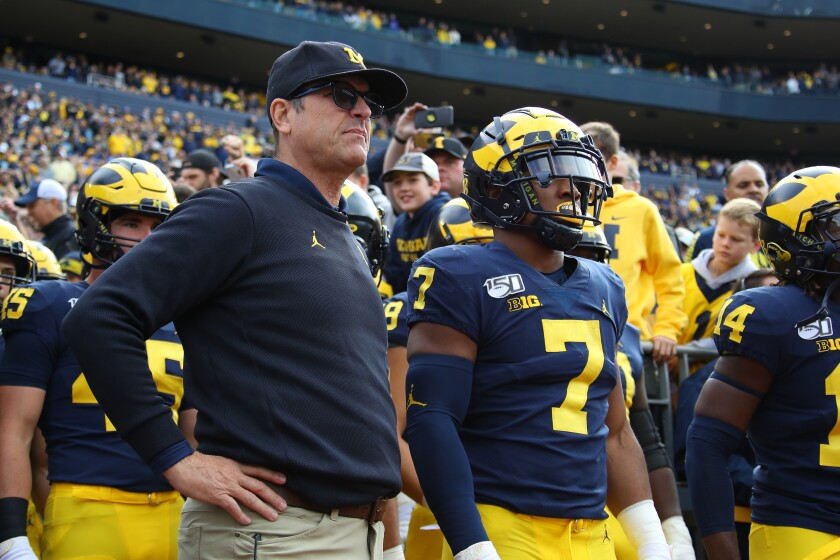 Michigan coach Jim Harbaugh waits to take the field before a game against Iowa on Oct. 5.