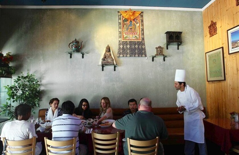 Chef Chudamani Adhikari checks on customers at Himalayan Cafe in Old Pasadena.