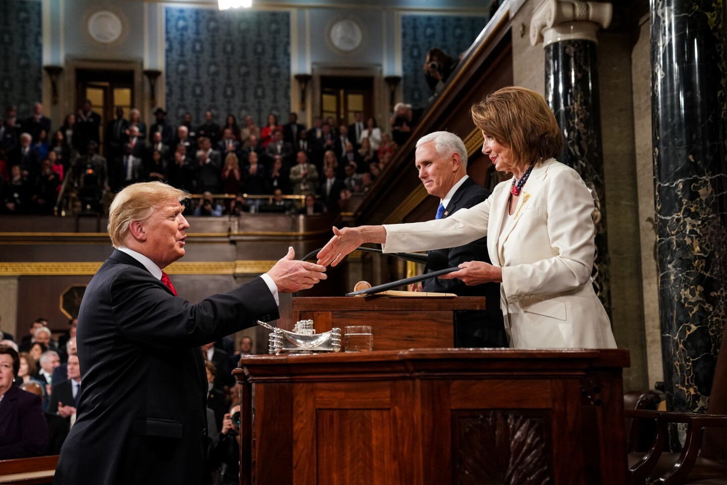 House Speaker Nancy Pelosi welcomes President Trump before his address.