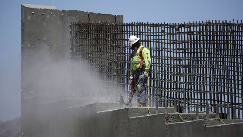 In this May, photo, a man works on the Southern Nevada portion of U.S. Interstate 11 near Boulder City, President Donald Trump has proposed a major push to promote a $1 trillion infrastructure program.
