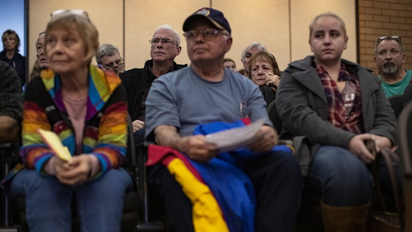 Camp fire evacuees wait to hear when they will be allowed back into Paradise to retrieve items from their burned properties during a town meeting at the Chico City Hall.