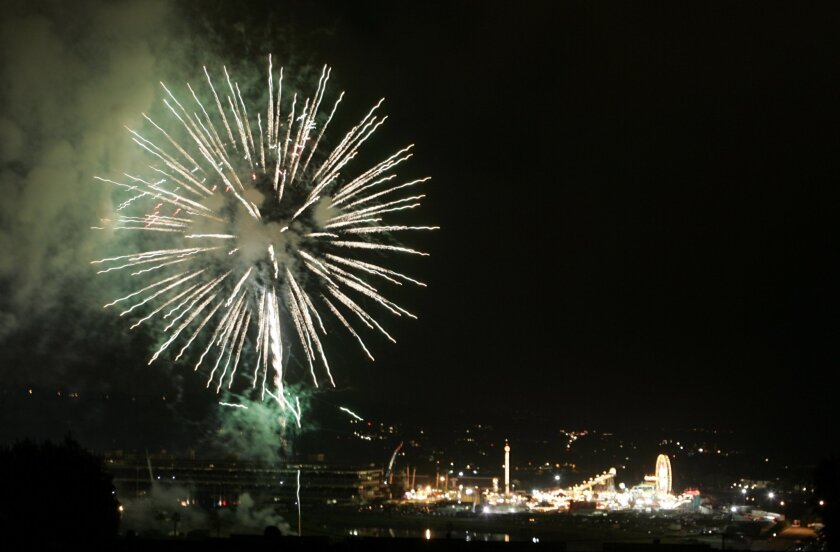 Fireworks explode over the Del Mar Fairgrounds at the 2013 run of the San Diego County Fair.