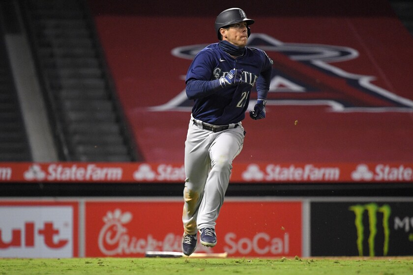 The Mariners' Dylan Moore rounds the bases after hitting a three-run homer in the sixth inning Wednesday night.