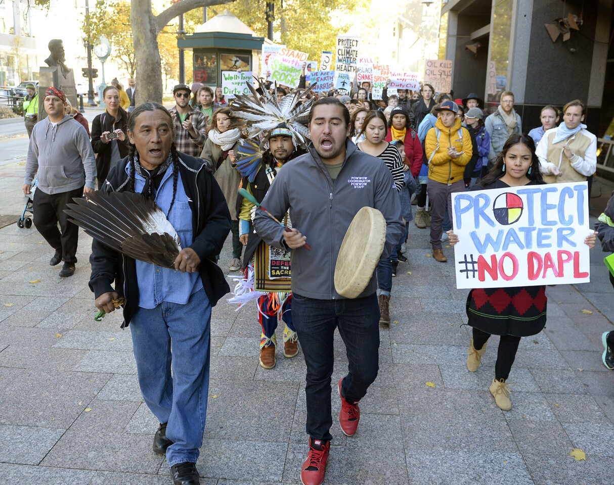 Protesters march in Salt Lake City on Monday in support of the Standing Rock Sioux against the Dakota Access Pipeline. The diverse group of more than 100 held a rally at the Gallivan Center, then marched half a block to the Wells Fargo Center building. Wells Fargo is one of several major banks financing the pipeline.