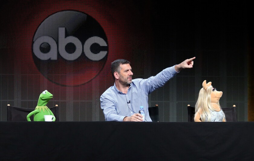 """Kermit the Frog, writer/executive producer Bob Kushell and Miss Piggy speak during the """"The Muppets"""" panel discussion at the ABC Entertainment portion of the 2015 Summer TCA Tour at The Beverly Hilton Hotel on Aug. 4, 2015 in Beverly Hills."""