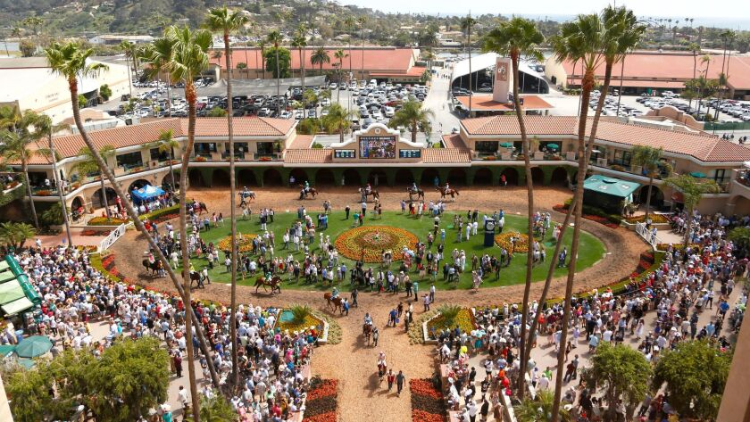 Horses make their way to the race track during Del Mar Opening Day.