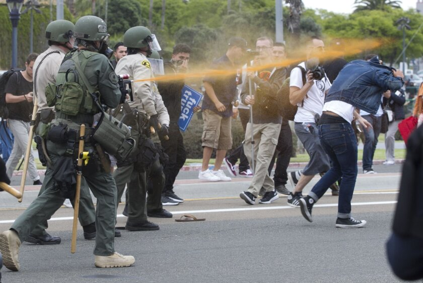 Police pepper sprayed protesters as they moved them down Harbor Drive on May 27 following Republican presidential candidate Donald Trump's speech at the convention center.