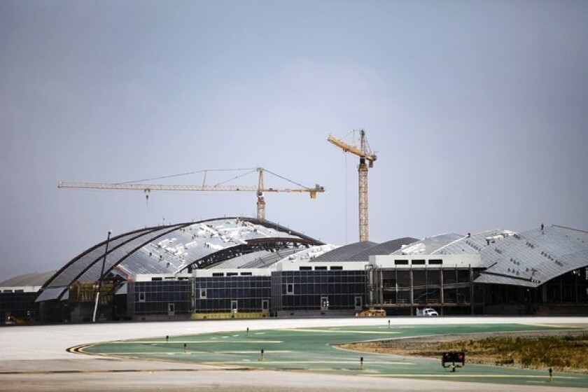 The Tom Bradley International Terminal under construction in May 2012, as part of an ongoing program of modernization at Los Angeles International Airport; a public relations campaign to highlight the LAX projects has drawn criticism.