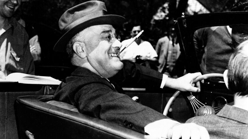 President Franklin Delano Roosevelt sits at the steering wheel of his automobile in Warm Springs, Ga. on April 4, 1939. That same year, Roosevelt formally created the executive office of the president, which served under a chief of staff.