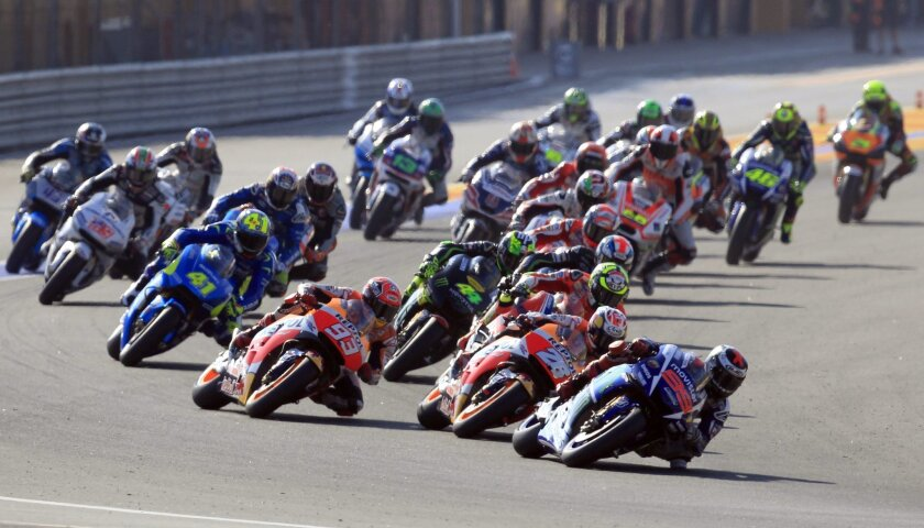 MotoGP rider Jorge Lorenzo of Spain leads the race during the Valencia Motorcycle Grand Prix, the last race of the season, at the Ricardo Tormo circuit in Cheste near Valencia, Spain, Sunday, Nov. 8, 2015. (AP Photo/Alberto Saiz)