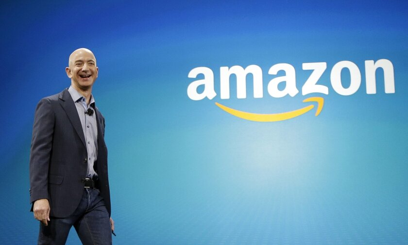FILE - In this June 16, 2014, file photo, Amazon CEO Jeff Bezos walks onstage for the launch of the new Amazon Fire Phone, in Seattle. Bezos offered a glimpse of his vision for the future during an interview on May 31, 2016, at the Code Conference in Rancho Palos Verdes, Calif. (AP Photo/Ted S. War