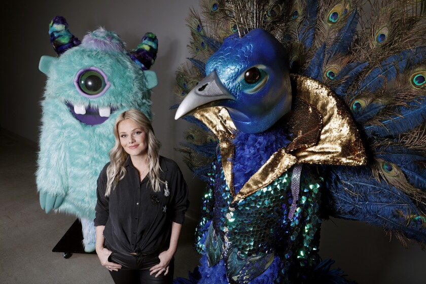 """Marina Toybina, costume designer for Fox's """"The Masked Singer,"""" with some of her creations."""