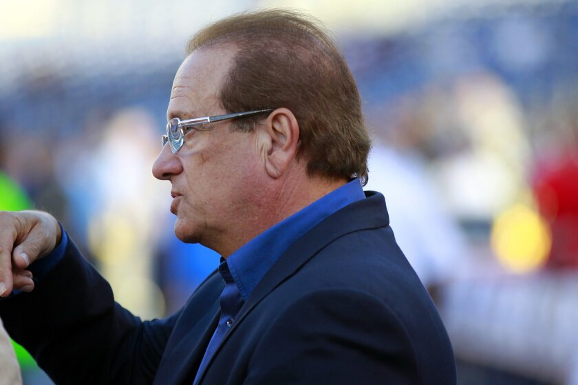 Chargers owner Dean Spanos talks with guests before the Seahawks game.