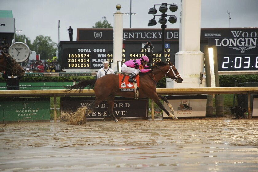 Maximum Security while crossing the finish line in the Kentucky Derby, at Churchill Downs in Louisville.