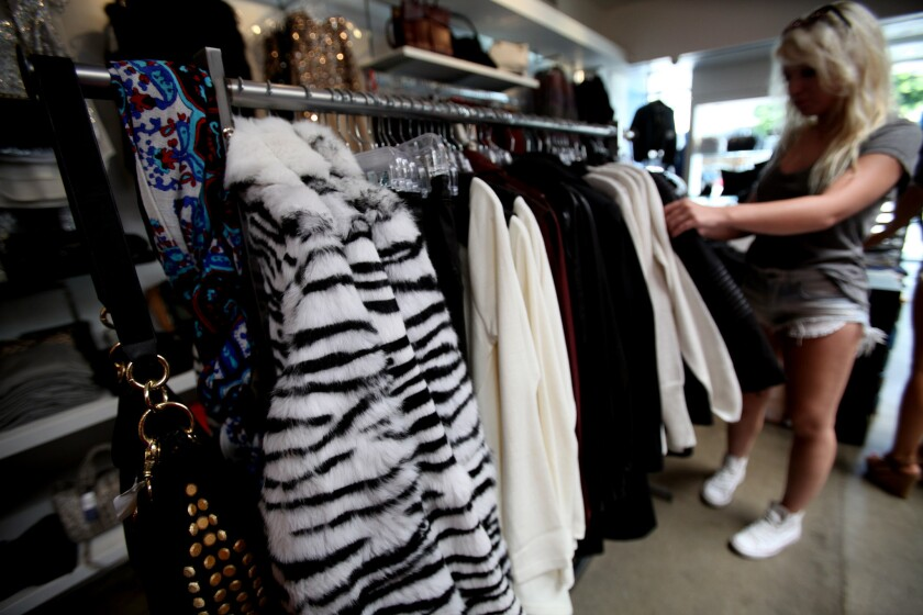 A shopper surveys the inventory at Kitson, the trendy clothing store on Robertson Boulevard in Los Angeles, which has a small selection of fur clothing, such as these zebra patterned jackets.