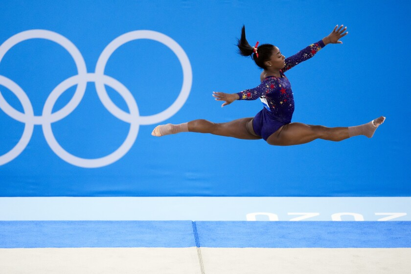 Simone Biles, of United States, performs her floor exercise routine.