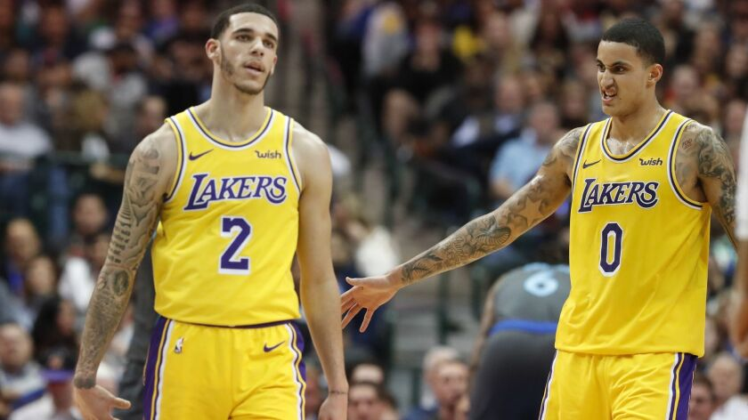 Lakers guard Lonzo Ball (2) and forward Kyle Kuzma (0) during the second half against the Dallas Mavericks on Monday.