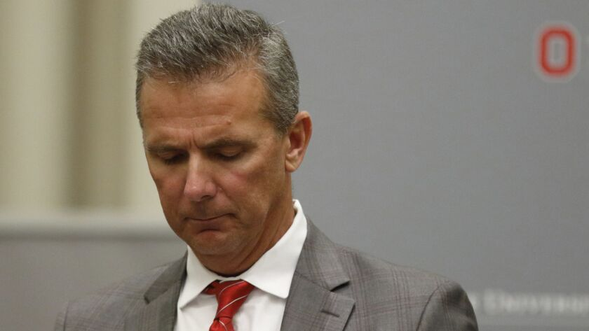 Ohio State football coach Urban Meyer makes a statement during a news conference in Columbus, Ohio, on Aug. 22 to announce the results of an investigation for the way he handled domestic-abuse allegations against a former assistant.