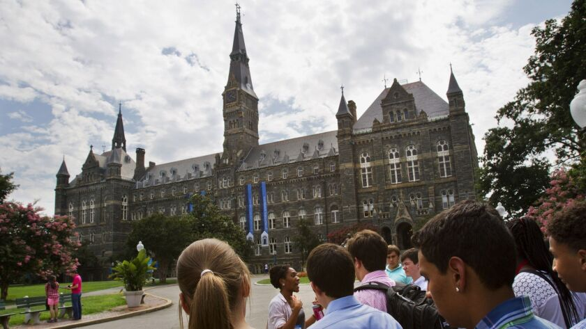 FILE - In this July 10, 2013, file photo, prospective students tour Georgetown University's campus i