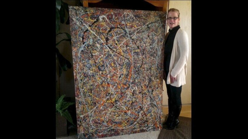 Renée Poissant posing with the painting . Photo courtesy Bill Page.