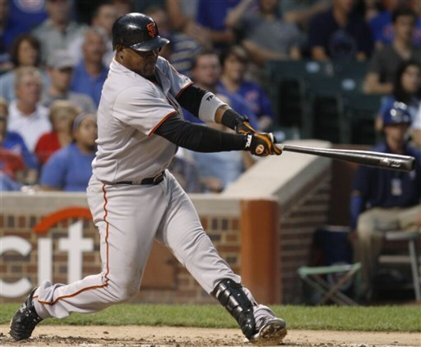 San Francisco Giants' Juan Uribe hits a two-run home run against the Chicago Cubs during the second inning of a baseball game Thursday, Sept. 23, 2010, in Chicago. (AP Photo/Nam Y. Huh)