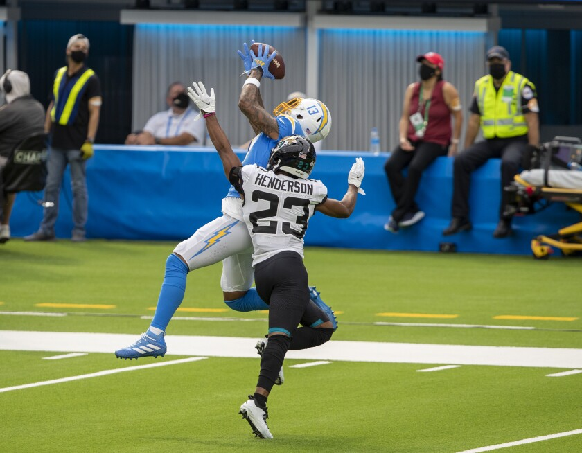 Chargers wide receiver Keenan Allen hauls in a pass over Jacksonville Jaguars cornerback CJ Henderson.