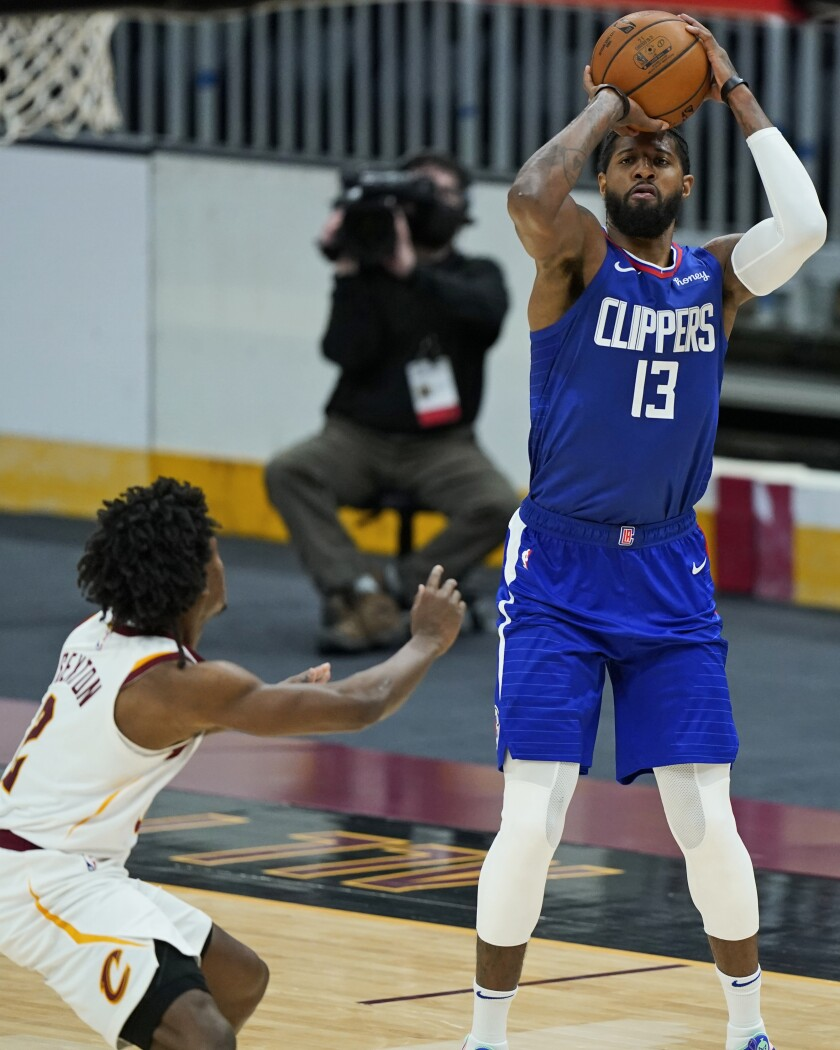 Los Angeles Clippers' Paul George (13) shoots against Cleveland Cavaliers' Collin Sexton (2) in the second half of an NBA basketball game, Wednesday, Feb. 3, 2021, in Cleveland. The Clippers won 121-99. (AP Photo/Tony Dejak)