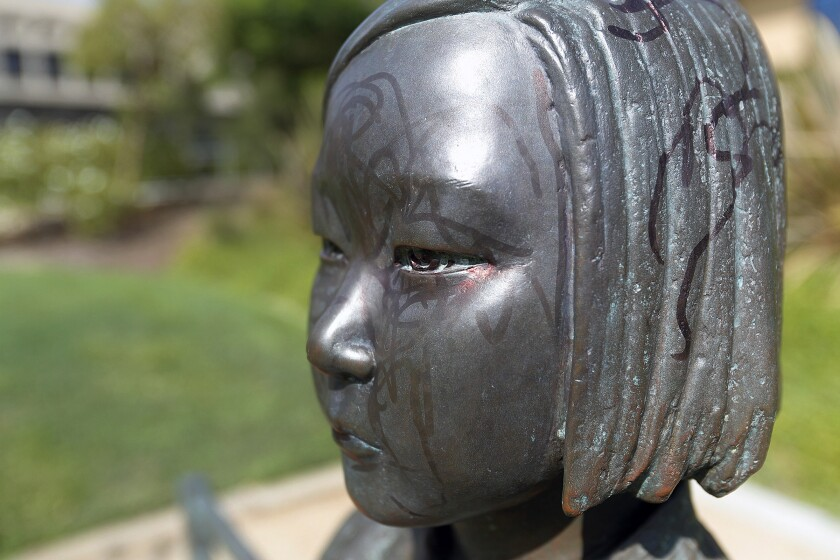 The Korean Comfort Women Peace Monument in Glendale's Central Park on Monday after it was vandalized by an unknown person who used a black permanent marker to scrawl all over the statute.