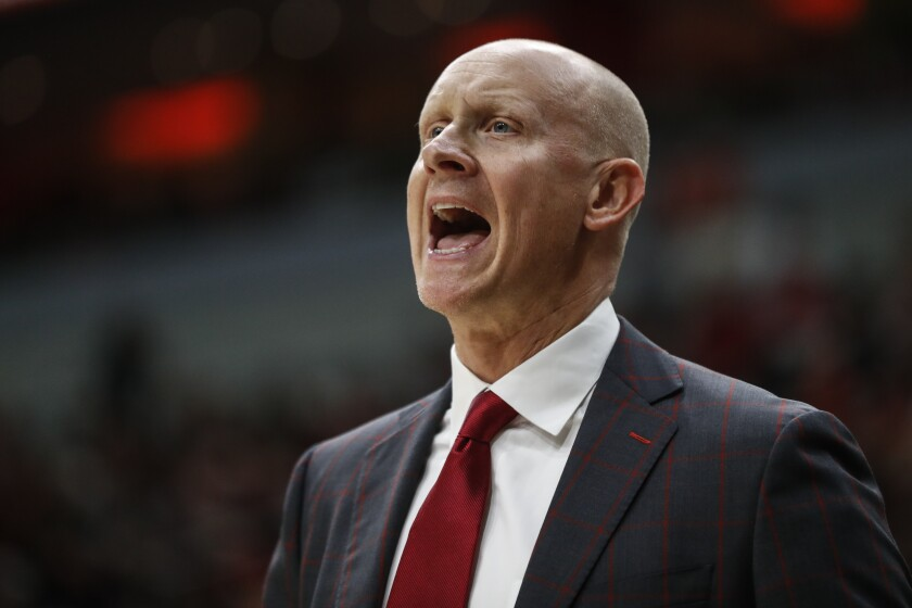 FILE - Louisville head coach Chris Mack yells to his players during the second half an NCAA college basketball game against North Carolina in Louisville, Ky., in this Saturday, Feb. 22, 2020, file photo. The NCAA has amended its Notice of Allegations against Louisville, adding additional violations committed by the men's basketball program that include impermissible activities and accusations coach Chris Mack did not promote an atmosphere for compliance. Already under review by the Independent Resolution Panel (IRP) for violations related to a college basketball corruption case detailed in a May 2020 NOA, the school received the amendment on Thursday, Sept. 30, 2021, from the governing body's Complex Case Unit. (AP Photo/Wade Payne, File)
