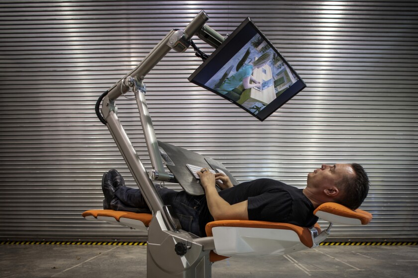 Che Voigt, CEO of Altwork, demonstrates the reclined position.