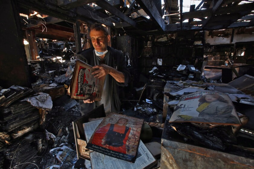 Richard Silva, 56, surveys the charred remains of his Encino home after a fire that caused moderate burn and smoke inhalation injuries to his 86-year-old mother Ruth Silva.